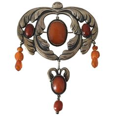 Art Nouveau Brooch in Silver with Amber from 1910-1920 | From a unique collection of antique and modern collectibles and curiosities at https://www.1stdibs.com/furniture/more-furniture-collectibles/collectibles-curiosities/
