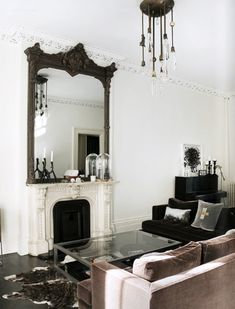 goth-living-room - gorgeous living room with ornate fireplace, huge mirror and velvet sofas