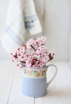 Cherry blossoms in a colorful pitcher. Hello Spring!