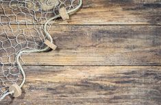 Fishing net background texture over rustic brown wood with copy space Wooden Background, Textured Background, Brown Wood, Image Now, Rustic Wood, Fish, Stock Photos, Caribbean, Pisces