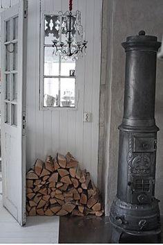 white washed walls + wood burning stove + chandelier = great shabby chic style! xoxo Beautylove Aprons