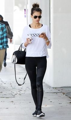 "Alessandra Ambrosio works it out in a white ""YASS"" tee and moto leggings"