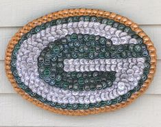 428 bottle caps 24 in. x 16 in. = kg DESIGNS: When viewing items on Etsy know that each item is created through the Eyes of the Artist. No two items will be exactly the same, each item is an original. Purchasers may place Beer Bottle Crafts, Beer Cap Crafts, Bottle Cap Projects, Diy Bottle, Beer Cap Art, Beer Caps, Bottle Cap Art, Bottle Cap Images, Green Bay