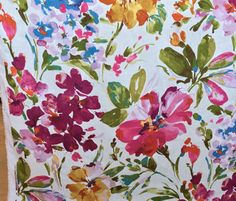 A completely gorgeous watercolor floral fabric.The colors are deep orchid and fuchsia pink, honey gold, teal and grass green, lavender and pacific blue, carrot