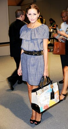 2008: Olivia Palermo wears a belted mini dress with statement earrings, peep-toe pumps, and a colorful leather tote bag
