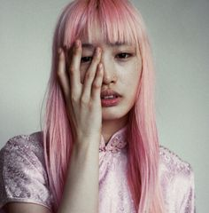 Fernanda Ly casting as Kandy Cotton. / She is a fairytale... a pink, magical fairytale! This face is sensuality! So sweet freckles... Dark, deep, beautiful, attractive, sensual and addictive eyes... Bushy eyebrows, cute lips, adorable hair... with this bang...This photo is an adventure! So sweet pose... So natural... There is something pure, wild, special and gorgeous in this photo! All this pink... I love it!