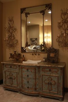 This is a custom made vanity in the master bathroom of Mrs. Jacquelyn Cain's home. This piece is eco-friendly and features a hand painted and hand crafted design that was specifically made for Mrs. Cain. Come visit us for an alluring experience or you can see more of our furnishings and decor at a local Houston showroom!