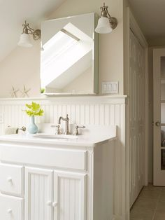 Beadboard bathroom. I like bringing it up higher, like about where you would hand towels or want a shelf