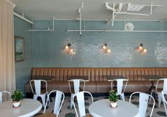 Great light reflecting tile and the leather booth seating is a great color compliment.