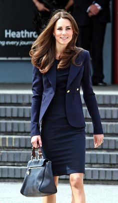On June 30, 2011, the Duchess departed London in a navy blue ensemble that included a Roland Mouret shift, Smythe blazer and Mulberry bag. The trip marked her first international travel as a royal. (Steve Parsons—WPA Pool/Getty Images)