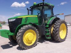 Sun splashed John Deere 7280R 308 max ,.280 engine,232 PTO from a turbocharged  548 cid diesel,27,180 lbs,144 gallon fuel tank,115 inch wheelbase.I wonder if this is the same 7280R  Tri  Green Tractor in July 2012