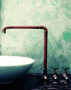 Copper pipe faucet - cheap, edgy (whatever that means) and industrial-looking at the same time.