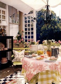 Shabby outdoor dining with china