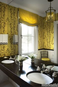 The powder room's existing citrus-yellow wallpaper looks even fresher with the addition of a window shade in a chartreuse-yellow silk.