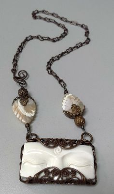 Pennsylvania jewelry designer Cynthia Riggs of Riggs Relics Jewelry created this wonderful pendant using Indounik's Buddha Eyes carved bone cabochon, Natural Brass from Vintaj, and carved natural mother of pearl leaves.