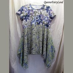 Q468, Up-cycled. This tunic is light to med muted bluish purples, lavender, and greens with light white and pale yellow flowers. Top was from Croft&Borrow XL. The skirt is a pale sage green with purple/lavender flowers with a little pale yellow and white flowers. The skirt is rayon