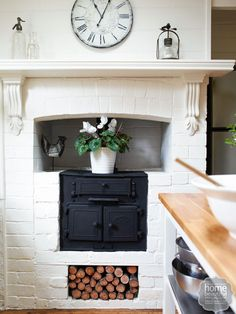 Rustic Retreat: new mantle and corbels blend seamlessly with the time-worn bricks. The antique style clock adds to the rustic feel.