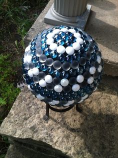 Click on the photo to find out how to make a beautiful glass pebble or flat glass marble orb for your porch, deck or patio.