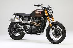 "Tridays Triumph Scrambler customized and renamed ""The Rumbler""."