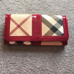 Authentic Berry Burberry wallet! New authentic Burberry check wallet! In perfect shape still have care cards and such from purchase! Burberry Bags Wallets