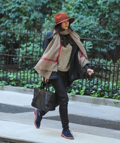 From the hat to the soles of her shoes and the minor stripe in the scarf, this outfit is brought to you by the colour, dusty rose.
