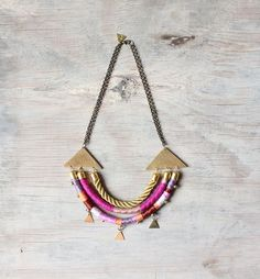 Rope necklace with hand crafted brass triangles