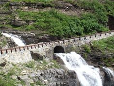 Taken at Glacier National Park, Montana. So very, very beautiful. Waterfall going under bridge. Simply gorgeous.