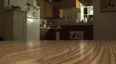 Is it a repeating gif or a game for the cat? (Click through to the original to see the animation.)