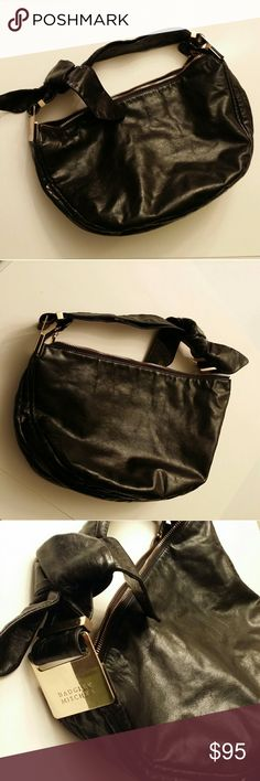 "Badgley Mischka leather hobo bag Gorgeous hobo style bag! Black zippered leather bag with a side knot bow, goldtone hardware, interior pockets. Measures approx. 16x9x5""  Gently used condition Badgley Mischka Bags Hobos"