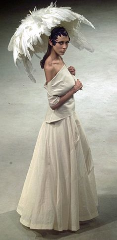 Yohji Yamamoto.  Love the feather umbrella