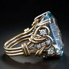 A liquid pastel blue aquamarine weighing carats is artfully presented in this bold retro mounting composed of intertwined, two-tone gold wire dotted with ten sparkling round diamonds. A unique and exceptional treasure, circa -- early Wire Jewelry, Antique Jewelry, Jewelry Rings, Jewelry Box, Jewelery, Vintage Jewelry, I Love Jewelry, Jewelry Accessories, Jewelry Design
