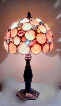 26. #Shell Lamp - 37 Shell Crafts to do when Summer's over ... → DIY [ more at http://diy.allwomenstalk.com ]  #Candles #Project #Shells #Terrific #Stepping