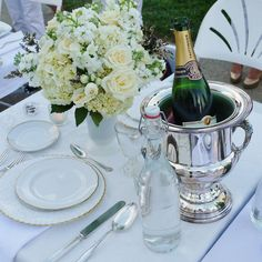 beautiful all white floral arrangement and very elegant formal table setting from Diner en Blanc Cincinnati, 2012.