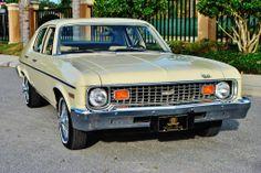 """1973 Nova 4 door with 19,000 original miles in """"light yellow"""". One owner since new."""