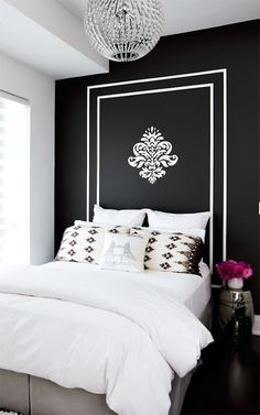 The perfect guest room. That black wall!!