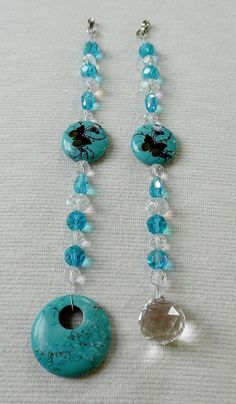 Ceiling Fan Pull Set with Turquoise, Butterflies and Crystals  This ceiling fan pull set comes with 2 pulls adorned with a Crystal Ball and a Genuine Turquoise Gemstone. Each pull is made of Crystal Clear and Teal Crystal beads, a Turquoise Butterfly Focal Bead and a silver connector that allows you to attach the pulls to any ceiling fan or light fixture with a standard ball chain. The Turquoise Pull measures 8 1/4 and the Crystal Ball pull measures 7 3/4. The Crystal Beads are faceted…
