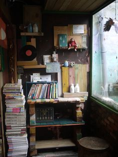 Shelves (hanging and floor) made out of colored wood planks.    Also, lots of books. <3