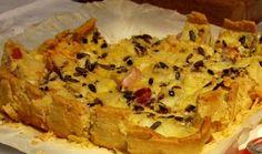 QUICHE TARNAISE (La pâte : 200 g de farine, 50 g de graisse de canard, 30 g de beurre pommade, 1 œuf, 1 pincée de sel) (GARNITURE : 3 jaunes d'œuf + 1 œuf entier, 30 cl de crème liquide, 150 g de cabécous (petits fromages de chèvre typiques du Sud-Ouest en général, du Tarn en particulier), 2 gousses d'ail rose de Lautrec pilées, 5 tranches de jambon fermier finement tranché (de Lacaune pour rester dans le Tarn), des graines de tournesol, poivre)