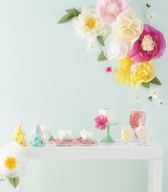 Giant paper flowers bring bursts of color to any wall, creating the perfect backdrop for a buffet or dessert table. Create a variety of sizes to use throughout the room.