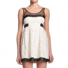 Lace dress with flared skirt with gros grain and tulle details.   http://shop.mangano.com/en/  #dress #black #fashion #apparel #clothing #woman #lace #mangano