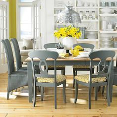 "Using a Contrasting color for a little ""Pop.""  I love the mix of chair styles and the metal fixture above"