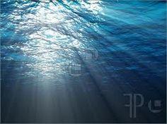 the beatiful sun seeping thru the water