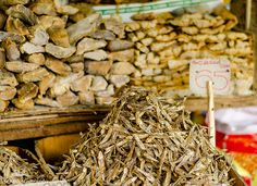 dried fish, market, Kandy, Sri Lanka by Secret Lanka. Arrangement of dried fish at the stall Little Island, India Travel, Kandi, Sri Lanka, Traveling By Yourself, Fish, Explore, Drink, Heart