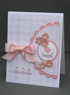 handmade baby card ... Pink!!! ...delightful pink bow, Prima flowers ... little bird ... plaid background papers ... off the edge circle focal point frame looks like a rattle ...  lovely card!!
