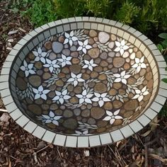 Mosaic bird bath birdbath Unique garden by RebeccaNaylorMosaicsFlannel flower design in a large terracotta water bowl measuring x 12 cms. Made to order. Please note this bowl doesn't sit on a pedestal but rather directly on the ground. Mosaic Stepping Stones, Pebble Mosaic, Mosaic Glass, Glass Art, Mosaic Birdbath, Mosaic Garden Art, Mosaic Art, Tile Mosaics, Mosaic Crafts