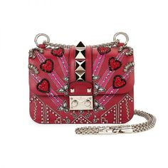 Embellished Bag - Nothing completes a fashion-girl look like a splashy bag. This Valentino heart-motif cross-body is positioned to be one of the most coveted accessories this year.