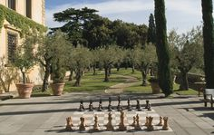 Imagine learning to play chess here!! Near Florence, the gardens of STING AND TRUDIE STYLER by LANDSCAPE DESIGNER ARABELLA LENNOX-BOYD. Architectural Digest