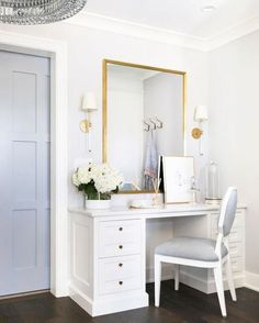 A white and gray octagon vanity chair sits at a white makeup vanity adorned with brass hardware and positioned beneath a gold framed mirror flanked by Camille Sconces. Bedroom Desk, Home Decor Bedroom, Bedroom With Vanity, Vanity Room, Parisian Bedroom Decor, Sala Glam, Beautiful Closets, Beautiful Space, Shabby Chic Interiors
