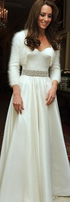 Created by Sarah Burton, Kate's dress for the Wedding Reception was a strapless white satin gazar evening dress with a circle skirt and diamante embroidered detail round the waist.