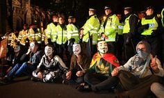 anonymous protestors in parliament square in 2013